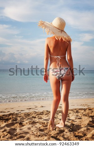 Beautiful young sexy woman relaxing on the beach - stock photo