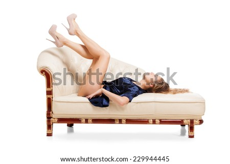 Beautiful young sexy woman sitting on chair - stock photo