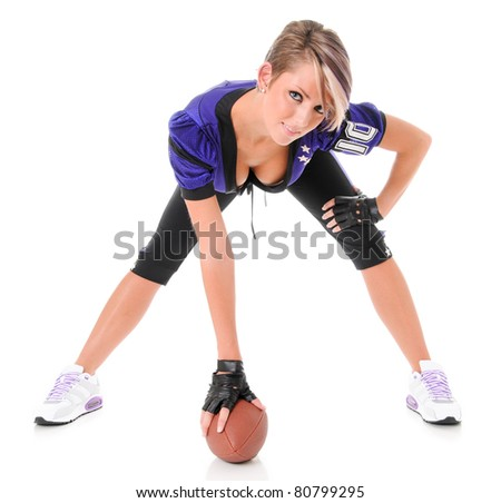 Beautiful Young Sexy Woman wearing American Football Uniform with Ball - stock photo