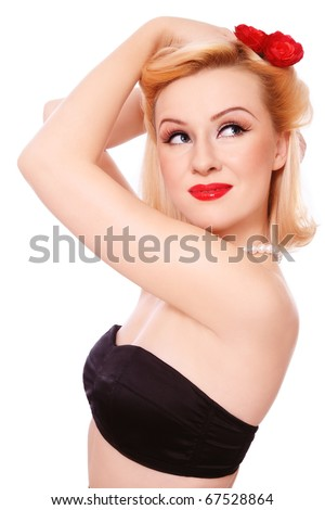 Beautiful young sexy woman with vintage make-up and hairstyle looking upwards with dreamy expression, on white background - stock photo