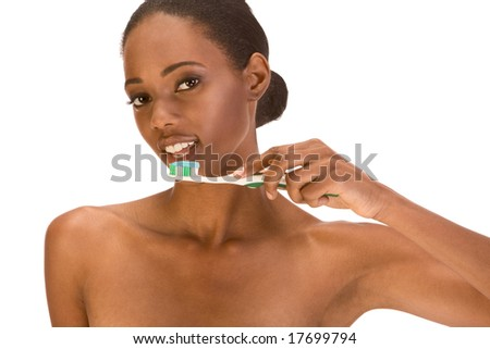 Beautiful young shirtless African-American woman with Slicked Back Hair with toothbrush and blue toothpaste - stock photo