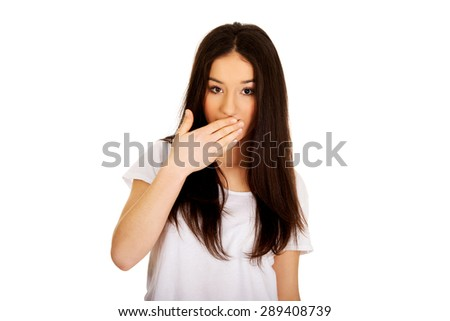 Beautiful young shocked student woman. - stock photo