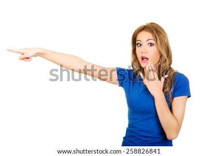 Beautiful young shocked woman pointing aside. - stock photo
