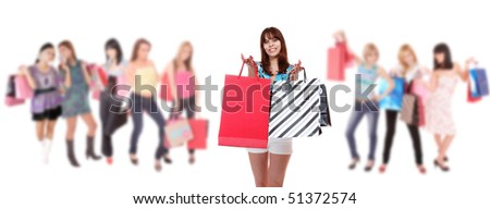 Beautiful young shopping woman with girls holding bags on background - stock photo