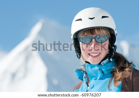 Beautiful young skier - stock photo