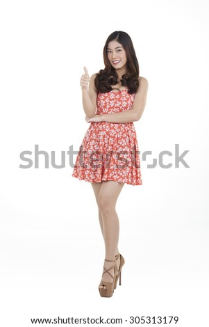 beautiful young slim asian woman wearing a dress isolated on white - stock photo