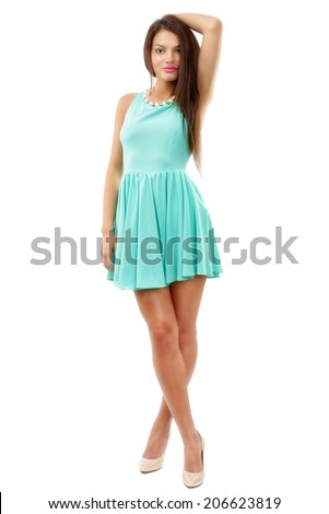 beautiful young slim brunette woman wearing a blue dress isolated on white - stock photo