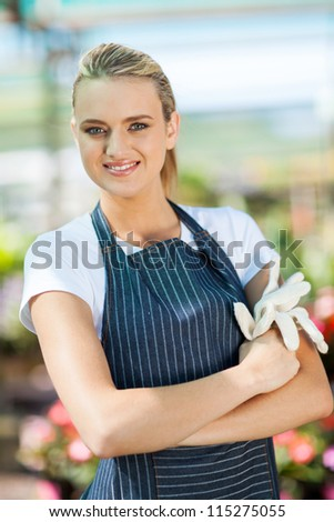 beautiful young small nursery business owner portrait in greenhouse - stock photo