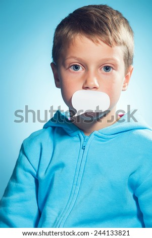 Beautiful young smiling boy with speech bubble on his mouth. Speechless, stunned, impatient something to say. - stock photo