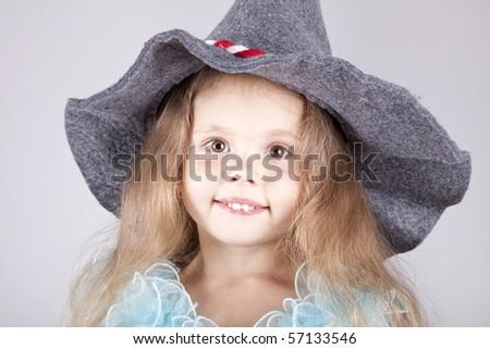 Beautiful young smiling girl in cap - stock photo