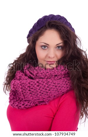 beautiful young smiling girl with hat and scarf in winter isolated on white background