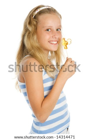 Beautiful young smiling girl with lollipop candy