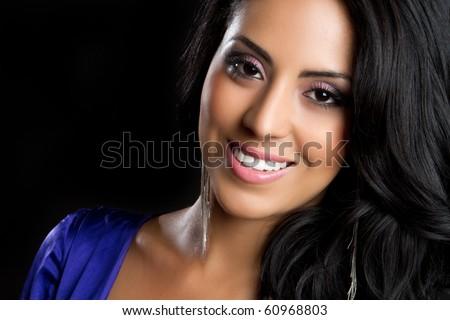 Beautiful young smiling hispanic woman - stock photo