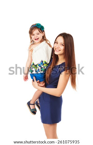 Beautiful young smiling sexy woman holding her smiling little daughter, isolated on white background - stock photo
