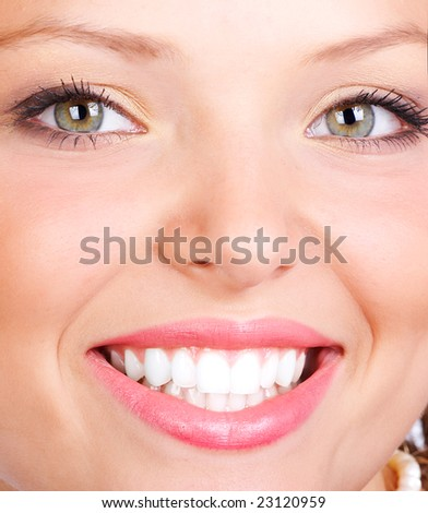 Beautiful young smiling woman face. Close up
