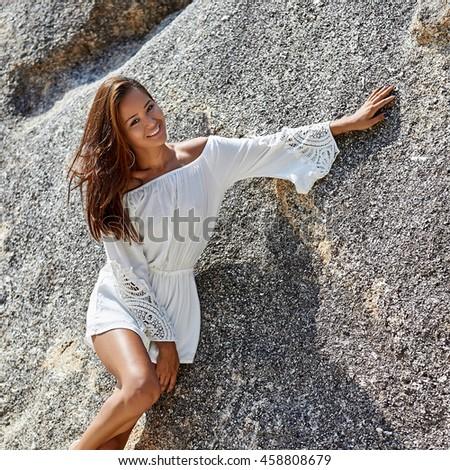 Beautiful young smiling woman having fun in summertime - stock photo