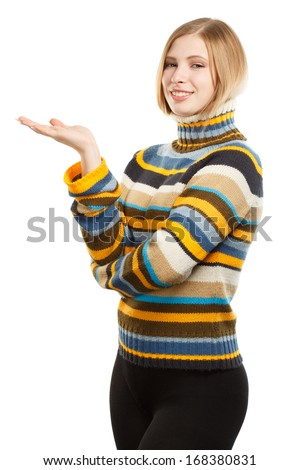Beautiful young smiling woman in colored striped sweater standing isolated on white background - stock photo