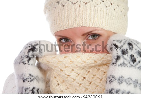 Beautiful young smiling woman in hat, scarf and mittens isolated on white - stock photo