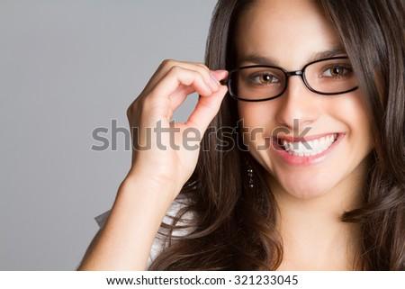 Beautiful young smiling woman wearing glasses - stock photo
