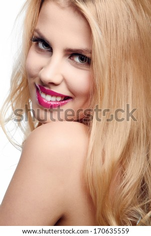 Beautiful young smiling woman with blonde hair  - stock photo