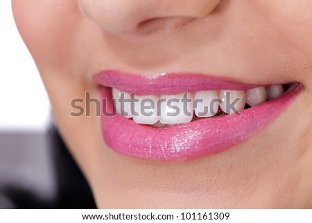 Beautiful young smiling woman with great teeth. Isolated over white background