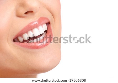 Beautiful young smiling woman with great teeth. Over white  background - stock photo