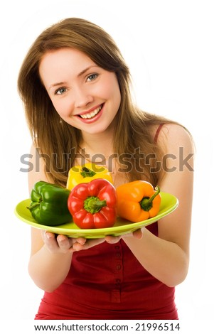 beautiful young smiling woman with peppers isolated against white background