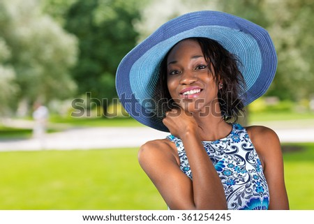 Beautiful young South African woman in blue hat close up