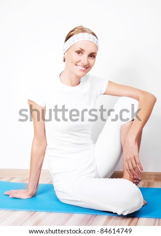 beautiful young sporty woman working out at home