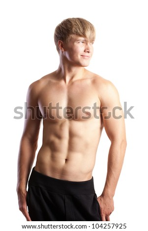 Beautiful young strong man posing on studio - stock photo