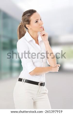 Beautiful young student,business woman thinking - stock photo