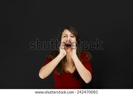 Beautiful young student over a chalkboard calling someone - stock photo