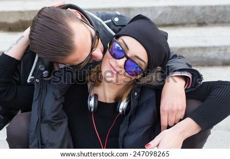 Beautiful young stylish couple loving and cuddling. - stock photo