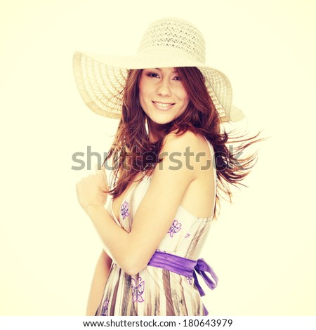 Beautiful young summer woman in hat, isolated on white background - stock photo
