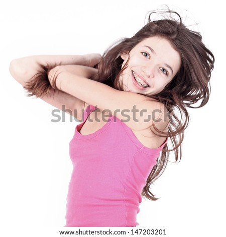 Beautiful young teen girl with brackets on teeth in white  - stock photo
