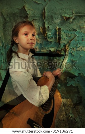 Beautiful young teenage girl with guitar musical instrument in old ruined room Grunge background. Toned image. - stock photo