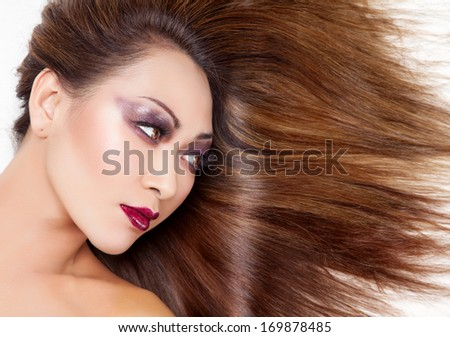 Beautiful young Thai woman with long elegant and shiny straight hair
