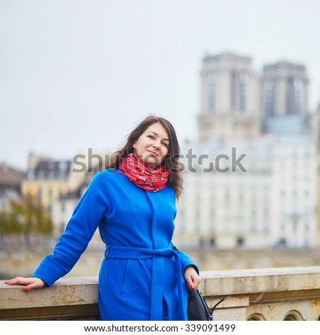 Beautiful young tourist in Paris on a fall day - stock photo