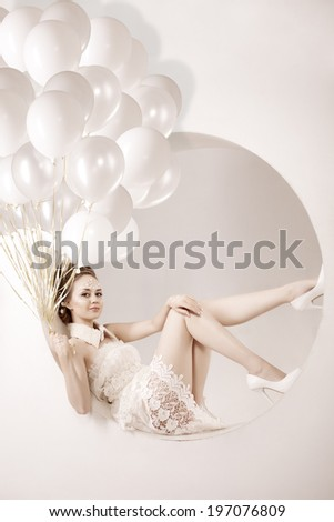 Beautiful young trendy modern smiling girl with balloons in jump. Stylish woman with balloons in hands. Stylish woman with balloons in hands - stock photo