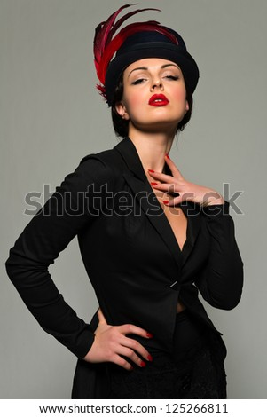 Beautiful young Ukrainian woman dressed in black - stock photo