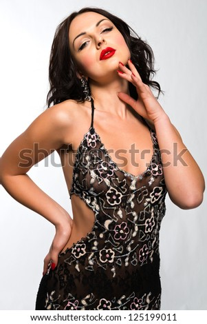 Beautiful young Ukrainian woman in a sheer brown dress - stock photo