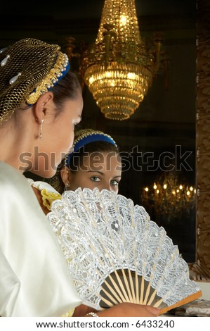 """Beautiful young victorian lady in front of a mirror in Castle """"Den Brandt"""" in Antwerp (Belgium) (signed property release for castle interior) - stock photo"""