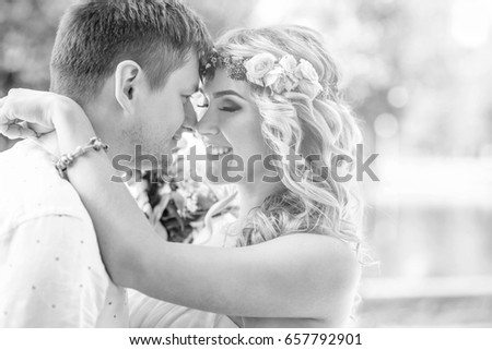 Beautiful young wedding couple outdoor in the park, black and white