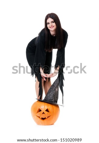 Beautiful young witch with halloween gourd isolated on white background