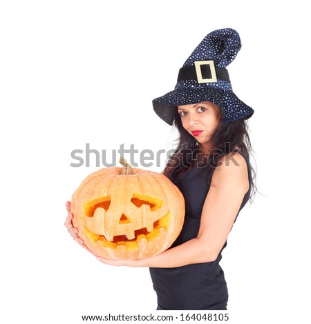 beautiful young witch with the Halloween pumpkin
