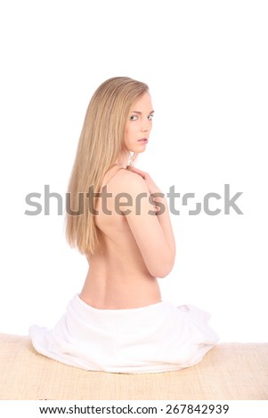 Beautiful young woman after bath with towel isolated on white background studio