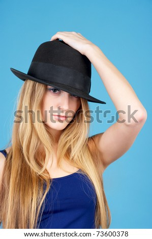 Beautiful young woman against blue background - stock photo