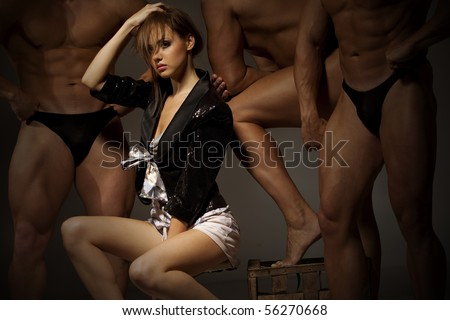 Beautiful young woman against three athlete