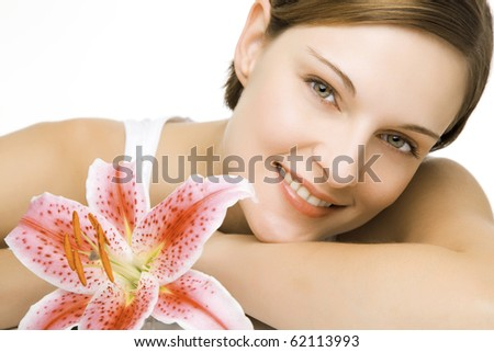 beautiful young woman and a lily in clean space - stock photo
