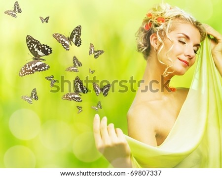Beautiful young woman and flying butterfly - stock photo